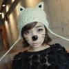 หมวกไหมพรมแฟชั่นเกาหลีพร้อมส่ง ทรงดีไซต์เก๋ ทรงหูแมว ลายกากบาท ปิดหูแต่งเชือกห้อย 2 ข้าง สีขาว