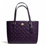 กระเป๋า COACH PEYTON OP ART EMBOSSED PATENT TOP  HANDLE TOTE F50540