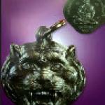 เหรียญหัวเสือรุ่นแรก เนื้อทองแดงรมดำ ปี ๒๕๒๓