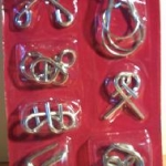 7 Metal Puzzles - 7 ตะขอปริศนาใน 1 เซ็ท