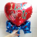 ลูกโป่งฟลอย์รูปหัวใจแดงผูกโบว์เล็ก พิมพ์ลาย I LOVE YOU ไซส์ 19 นิ้ว - I Love You Heart Shape Foil Balloon / TL-E059
