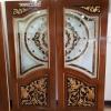 ประตูไม้สักกระจกนิรภัยปีกนก แกะดอกไม้ เนื้อไม้เรือนเก่า เกรดA. AAA13